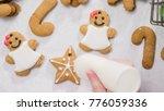 decorating gingerbread cookies... | Shutterstock . vector #776059336