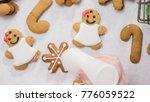 decorating gingerbread cookies... | Shutterstock . vector #776059522