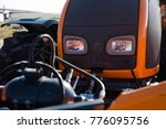 Small photo of forepart of new, black and orange tractor, close-up photo