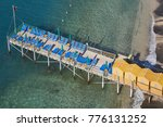 sun loungers on the water  ... | Shutterstock . vector #776131252