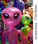 Small photo of Bright colored alien doll
