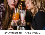 young woman drinking milkshake... | Shutterstock . vector #776149012