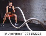 woman training with battle rope ... | Shutterstock . vector #776152228