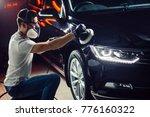 car polish wax. worker hands... | Shutterstock . vector #776160322