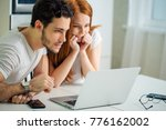 young couple browsing internet... | Shutterstock . vector #776162002