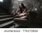 beauty sitting in an armchair  | Shutterstock . vector #776172826