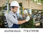 modern factory worker with... | Shutterstock . vector #776174938