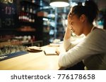 tired waitress reading notes... | Shutterstock . vector #776178658
