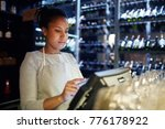 pretty young cashier... | Shutterstock . vector #776178922