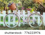 bicycle with basket of flowers... | Shutterstock . vector #776223976