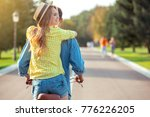 couple riding bicycle together... | Shutterstock . vector #776226205