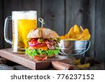 cold beer and hamburger made of ... | Shutterstock . vector #776237152