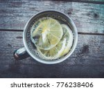 lemon tea in a metal mug on a... | Shutterstock . vector #776238406