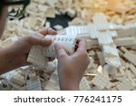 top view on child's hands... | Shutterstock . vector #776241175