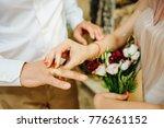 exchanging wedding rings | Shutterstock . vector #776261152
