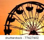 Silhouette Of Ferris Wheel At...