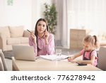 busy young woman with daughter... | Shutterstock . vector #776278942