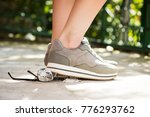 woman at the walk stepped on... | Shutterstock . vector #776293762