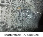 an exotic car is under washing and cleaning process at a car wash and polish garage   - stock photo
