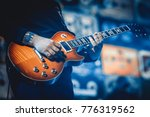 man playing guitar on the... | Shutterstock . vector #776319562