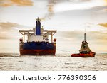 tug boat towing a tanker ship... | Shutterstock . vector #776390356