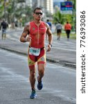 Small photo of Caioba, Brazil - April 27, 2014: Brazilian triathlete Eduardo Junior running at the Triathlon Heroes First Stage race.