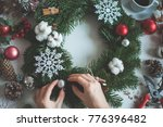 florist's hands with christmas... | Shutterstock . vector #776396482