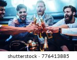 group of men toasting with beer | Shutterstock . vector #776413885