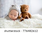 sweet baby boy in bear overall  ... | Shutterstock . vector #776482612