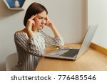 head pain of young freelance... | Shutterstock . vector #776485546