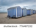 row of blue and white beach... | Shutterstock . vector #776487232