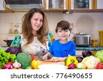 the young cook mother standing... | Shutterstock . vector #776490655