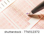 close up of person hand marking ... | Shutterstock . vector #776512372