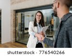 warm welcome and a handshake... | Shutterstock . vector #776540266