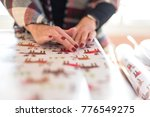 woman wrapping christmas gifts... | Shutterstock . vector #776549275