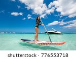 beautiful woman has surfing in... | Shutterstock . vector #776553718