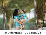 portrait of beautiful mother... | Shutterstock . vector #776558125
