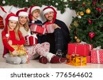 cheerful family with christmas... | Shutterstock . vector #776564602