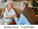 romantic senior couple holding... | Shutterstock . vector #776565406
