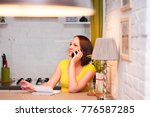 woman with phone and notebook.  ... | Shutterstock . vector #776587285