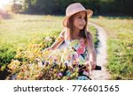 beautiful little girl riding a... | Shutterstock . vector #776601565