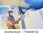 worker with sledgehammer at... | Shutterstock . vector #776608762