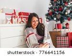 beautiful young woman using... | Shutterstock . vector #776641156