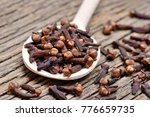 wooden spoon with cloves on... | Shutterstock . vector #776659735