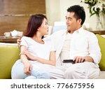 asian couple sitting on family... | Shutterstock . vector #776675956