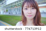 young woman looking at camera | Shutterstock . vector #776713912