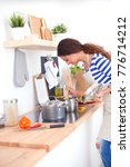 young woman in the kitchen... | Shutterstock . vector #776714212