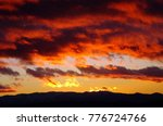 A Dramatic Fiery Sunset In...