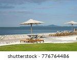white color recliner beach... | Shutterstock . vector #776764486