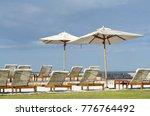 white color recliner beach... | Shutterstock . vector #776764492